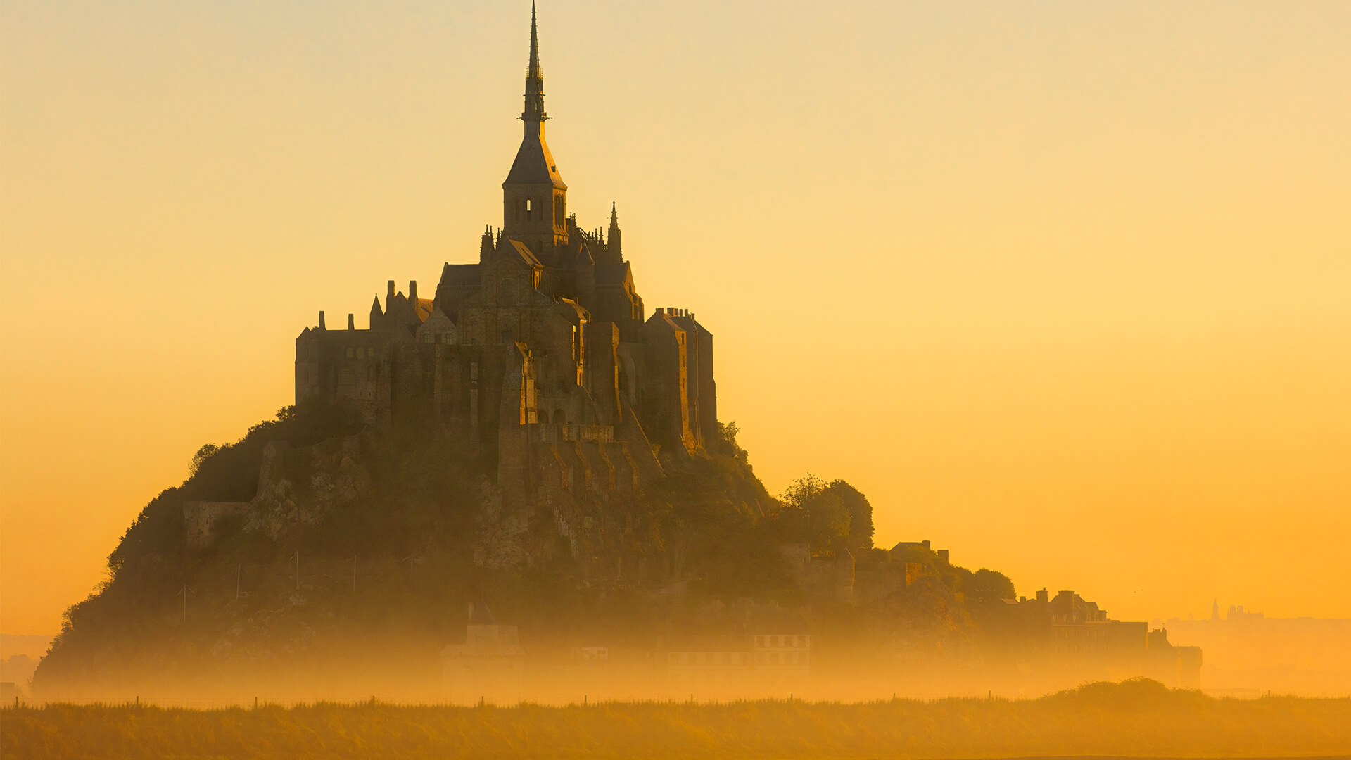 Sepia photo of Mont Saint-Michel, France on foggy day